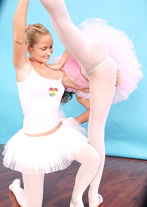 Two blonde teen ballerinas love to use some toys together