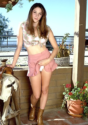 Naughty brunette teenie cowgirl spreading her pink pussy