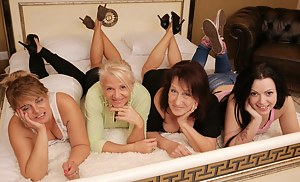 Four old and young lesbians having a ball
