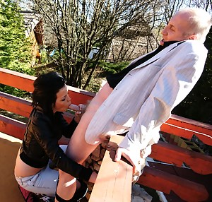 Naughty babe fucking and sucking a dirty old man outside