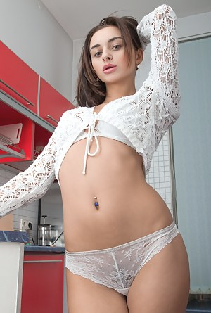 Dominika Sand is tall and lovely in lingerie while in her kitchen. She strips naked and climbs on her counter. There, she spreads her legs and flaunts her hairy pussy and her beautiful natural breasts.