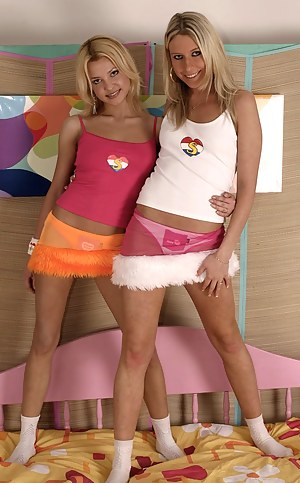 Two blonde teenage honeys spreading their sexy long legs
