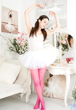 Naughty ballerina pleasures her bald pussy in her tutu