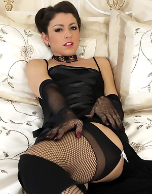 Glamorous brunette is simply irresistible in this saucy sexy bed time striptease.