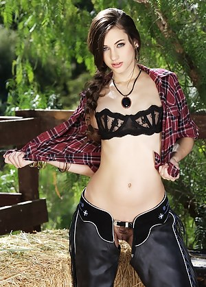 Gorgeous teen Georgia Jones toys pussy in the stables.