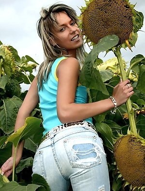 Dutch teenage cutie toying her pussy in a sunflower field