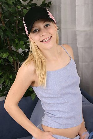 Teen nubile leah bites down on her pink trucker hat pretending to be angry grrr