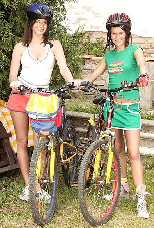 Two lesbo teens toying pussy outdoor after their bmx ride