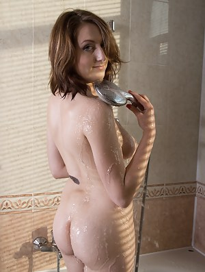 Sandy is a sexy 18-year old Russian who has a beautiful figure. The dress and panties come off before she goes to the tub. There, she gets all wet and plays with her wet body and wet pussy.