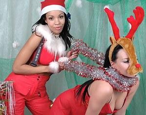 Teenage Mrs Santa posing with her sexy reindeer girlfriend