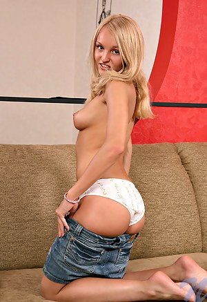 Great reba strips off her undies with smile and to shows her clit on couch
