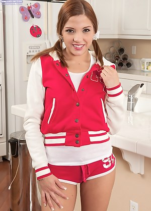 Redhead teen Evilyn Fierce strips off her school letter jacket.